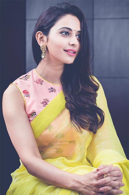 Rakhul preeth in plain yellow Saree