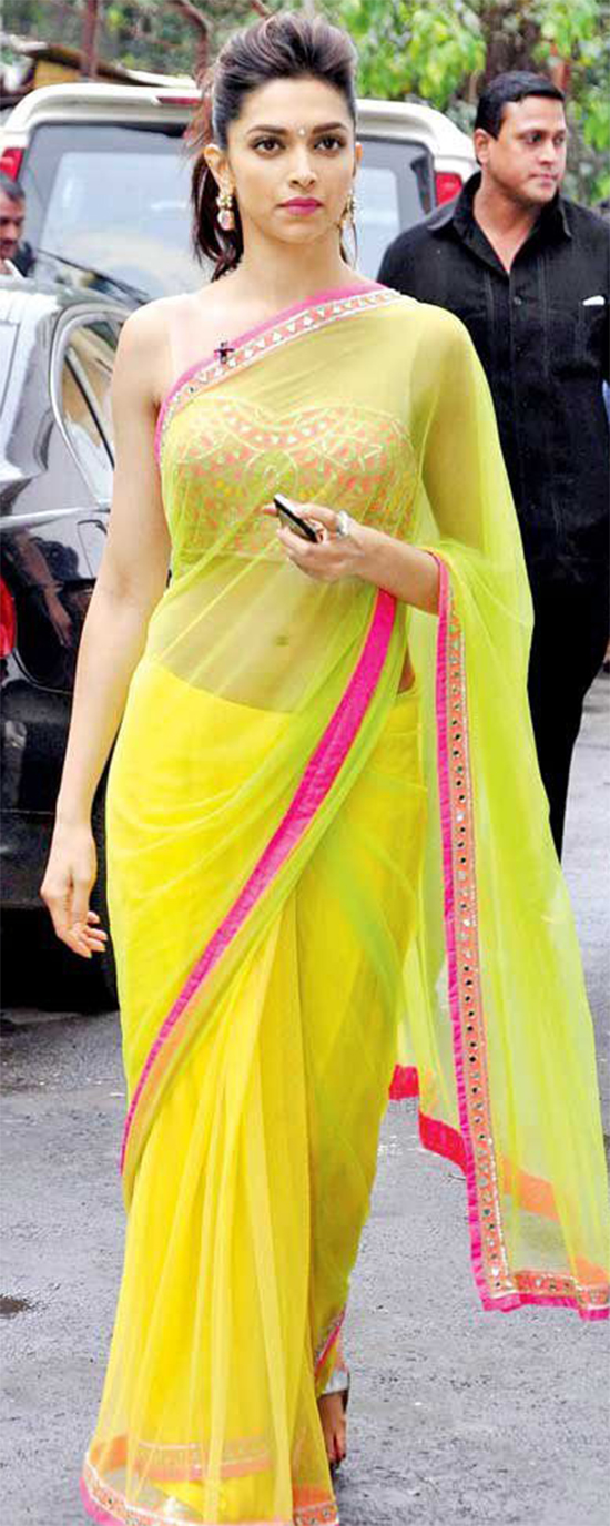 Deepika Padukone In Yellow Net Saree With Embroidery Blouse
