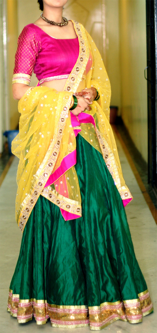 Green Lenhenga With Golden Heavy Sequins Lace & Kundan Work Dupatta With Yellow Border & Hot Pink Narrow Lace With Leafy Design Blouse