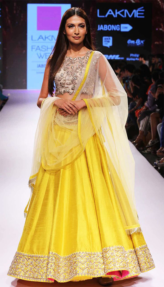 Simple & Sober Bright Yellow Designer Lehenga With Embroidered Blouse & Netted Choli